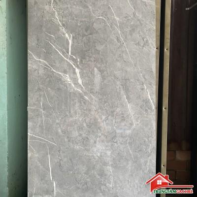 Gạch lát nền màu xám vân trắng 60x120 bóng kiếng phòng khách